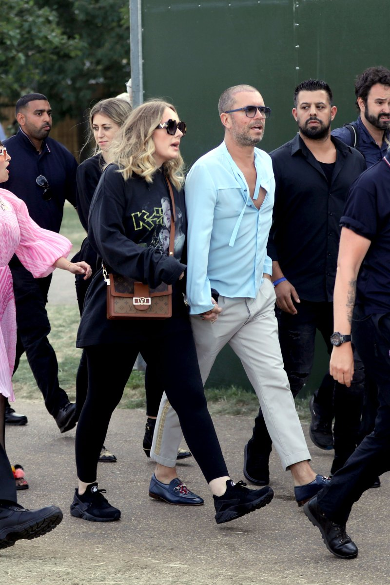 Adele-Shows-Off-Her-Slimmer-Figure-as-She-Holds-Hands-With-Male-Pal-02